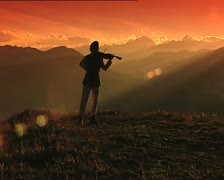Violinist silhouette at sunset full shot 3 Stock Footage