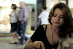 Three friends in restaurant eating dinner in the evening, steadycam shot Stock Footage