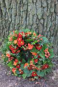sympathy flower arrangement in red - stock photo