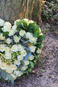 heart shaped sympathy flower arrangement - stock photo