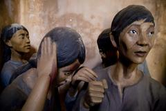 Wax figures in the Vietnamese war prison and museum, Con Dao island in Vietnam. - stock photo