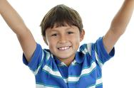 Young boy with arms up Stock Photos