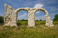Ancient Roman arches under the sun in Burnum site Stock Photos