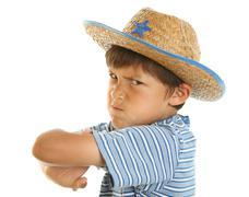 Nuori vihainen poika cowboy hattu Kuvituskuvat