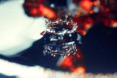 Liquid drop falling Stock Photos