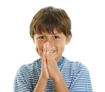 young boy smiling with hands together - stock photo