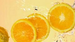 Sliced orange in water, Slow Motion - stock footage