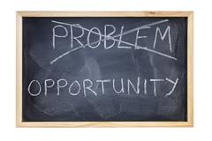 problem is opportunity blackboard concept - stock photo