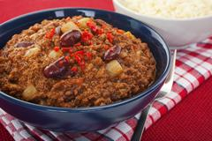 tex- mex chilli with beans and white rice - stock photo