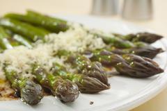 Asparagus with parmesan and balsamic vinaigrette Stock Photos