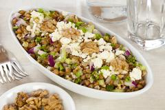 Lentil salad with walnuts, feta and celery Stock Photos