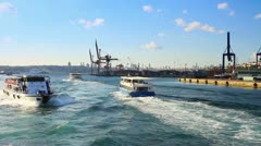 Istanbul ferry boats sailing in front of Haydarpasa docks Stock Footage