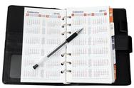 Stock Photo of calendar in notebook with pen