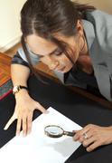 Woman looks on document Stock Photos