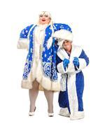 Travesty actors genre depict santa claus and snow maiden Stock Photos