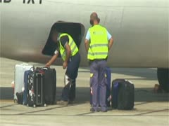 Airport worker loading baggage Stock Footage