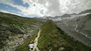 Woman Trekking toward Glacier Stock Footage