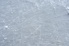 Skate marks on the surface of an outdoor ice rink - stock photo