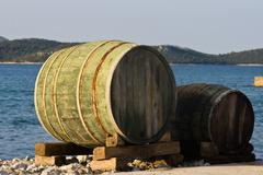 Old wooden barrels on the island Krapanj waterfront Stock Photos