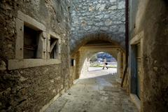 Old stony street with an arch on island Krapanj Stock Photos