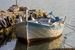 Old fishing boats on a stony pier on island Krapanj - stock photo