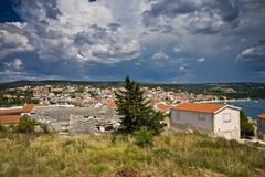 Primosten panorama with rainy clouds Stock Photos