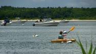 Girls paddle kayaks Stock Footage