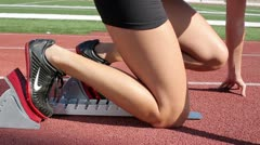 Closeup Legs at Starting Block Stock Footage