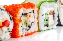 Sushi roll on a white background Stock Photos