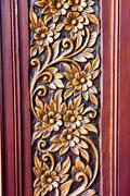 Wood carving of flowers and leaves Stock Photos