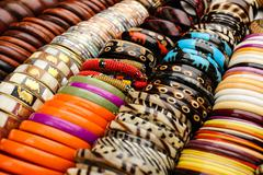 many braclets at african market - stock photo