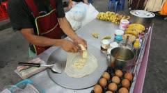 Street vendor making banana crepe Stock Footage
