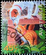 Australia stamp shows dag and cat Stock Photos