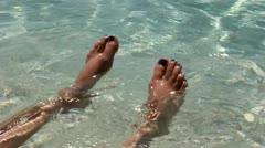Soaking Feet in the Ocean Stock Footage