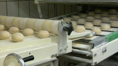 Roll bun on conveyor belt dolly wide Stock Footage