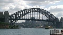 Ferries crossing harbour bridge Stock Footage
