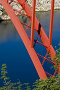 Red bridge and blue water - stock photo