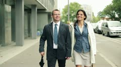 Businesspeople walking and talking in the city, steadycam shot Stock Footage