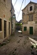 Stony streets and houses of Pirovac - stock photo