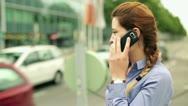 Businesswoman talking on cellphone on the street, steadycam shot Stock Footage