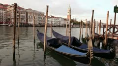 Two traditional Venetian gondolas parked on Grand Canal Stock Footage
