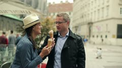 Young tourist couple enjoying an ice cream treat at the vacation Stock Footage
