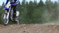 Two bikers ride over hill, closeup view during motorbike race Stock Footage