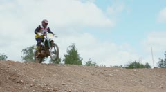 Motorcyclists ride over hill, closeup view during motorbike race Stock Footage