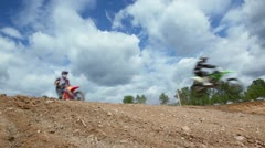 Bikers ride over hill, closeup view during motorbike race Stock Footage