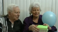 Stock Video Footage of Senior Woman Opens Gift Fun