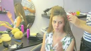 Model with hairdresser Stock Footage