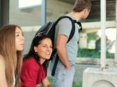 Young happy friends chatting and waiting for a bus, steadicam shot NTSC Stock Footage