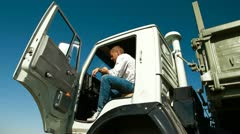 Truck Driver in Cab Using Mobile Phone Stock Footage