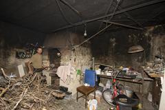 Man on his fireplace Stock Photos